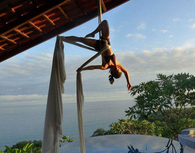 Arial Yoga Above The Infinity Pool