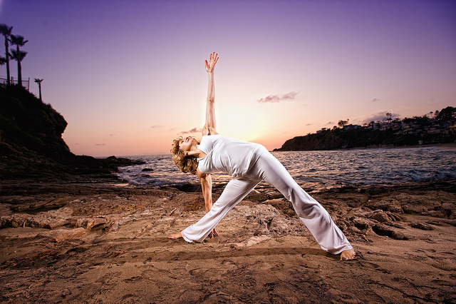 Extended triangle pose (via flickr https://www.flickr.com/photos/hollymosier/4769636120/)